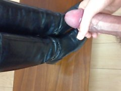 Huge, thick cumshot over wife's leather riding boots