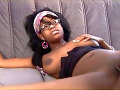 Black snake penetrates young ebony in glasses