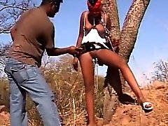 African sex slave gets boot spanked while being tied to tree