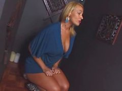 Blonde in a blue dress sucking at gloryhole