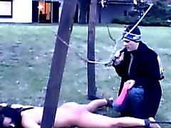 Sexy slave tortured outdoors and restrained