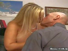 Curvy blonde Abbey gives head to muscled Johnny Sins