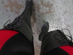 strutting in leather lace up and rear zipper thigh boots