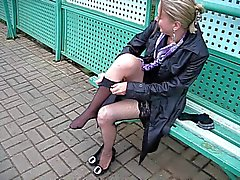 Girl changes stockings on a train station