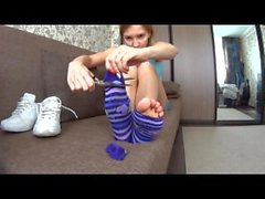 Cute Girl Cuts off her Colorful Socks to Expose Toes
