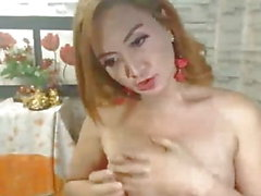Shemale Babe Strokes her Big Dick in Solo Masturbation