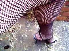 Fishnets tights close up and upskirt