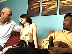Rei Minami sucks cock while is screwed in interracial