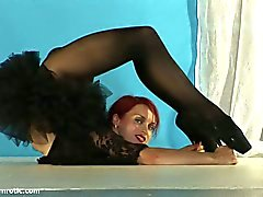 Redhead gymnast athlete with firm tits so flexible