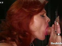 Gloryhole Secrets mature redhead swallows cum