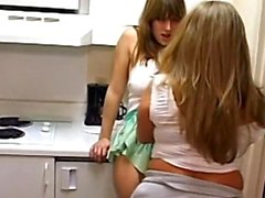 Two thick amateur lesbians get naughty in the kitchen