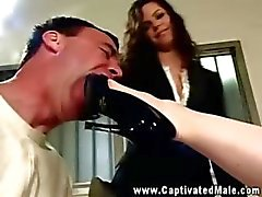 Bobbi Starr and Madison Young playing with ball gagged patient