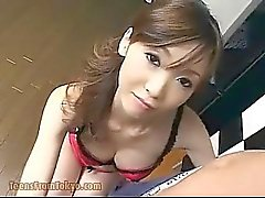 Asian girl gives blow job in the kitchen