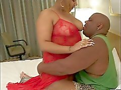 Big thick black girl in lingerie with giant tits loves to suck her man's dick