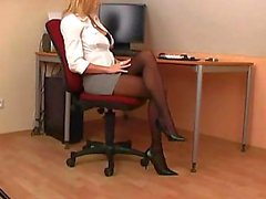 Hot secretary showing pantyhose and feet