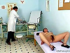Karin gets speculum inserted deep inside her hairy puss