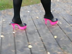 Lady L walking with pink mules.