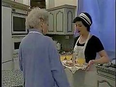 French maid fists a mature slut in the kitchen