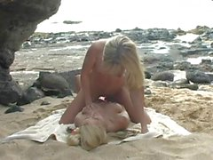 Sandy Summers and Jana Jordan lesbian strap-on sex at the beach