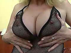 Busty MILF playing with hard nipples