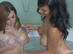 Taylor and Jelena play with each other's tits in the tub