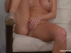 Busty blonde Samantha Saint fingers her pussy