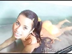 Petite teen Lupe Fuentes posing in a transparent glass tank