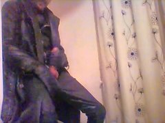 Wank in new leather trenchcoat