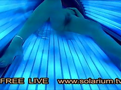 Hot Horny Girl masturbates in Public solarium